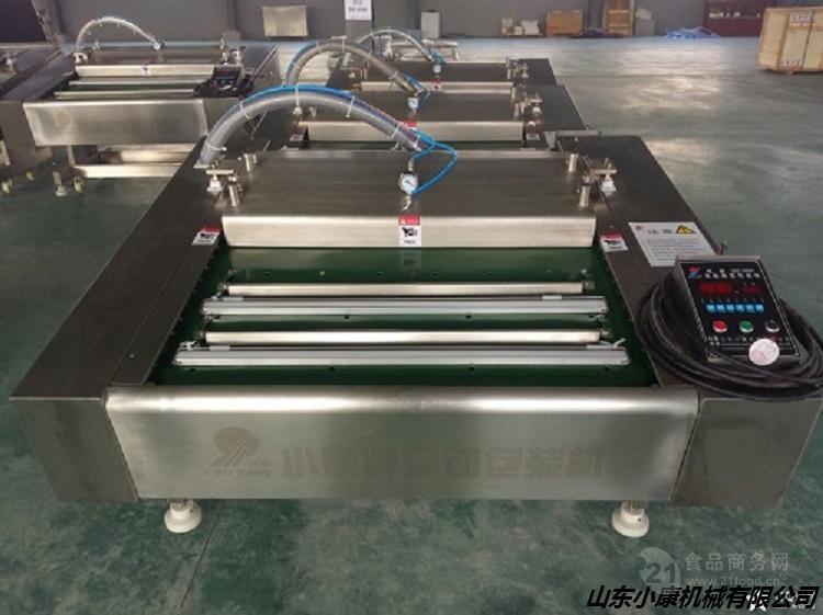 厂家特供小康牌DZ-1000型辣条滚动式真空包装机