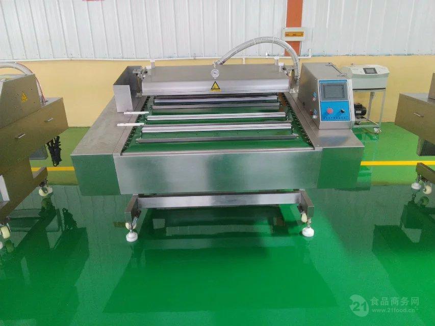 防水型竹笋自动滚动式真空包装机