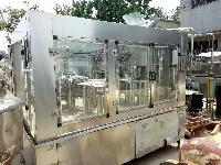 供应二手三合一饮料灌装机、油类罐装机、自动化罐装机