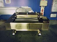 小康DZ-1000型滚动全自动真空包装机